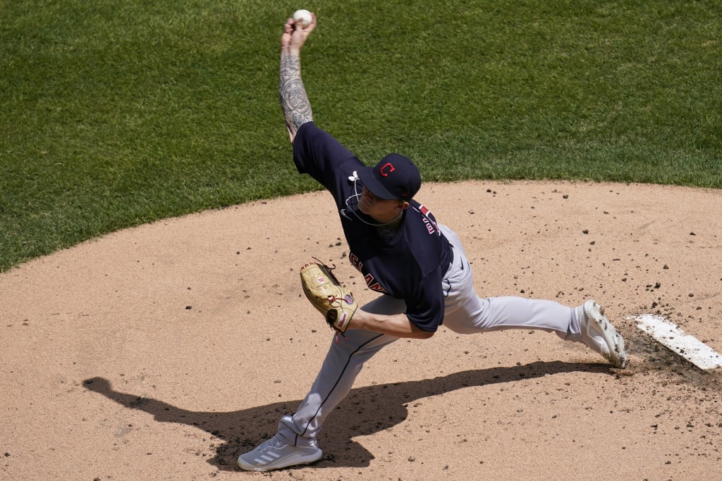Cleveland Indians starting pitcher Zach Plesac throws against the Chicago White Sox during the first inning of a baseball game in Chicago, Sunday, May...