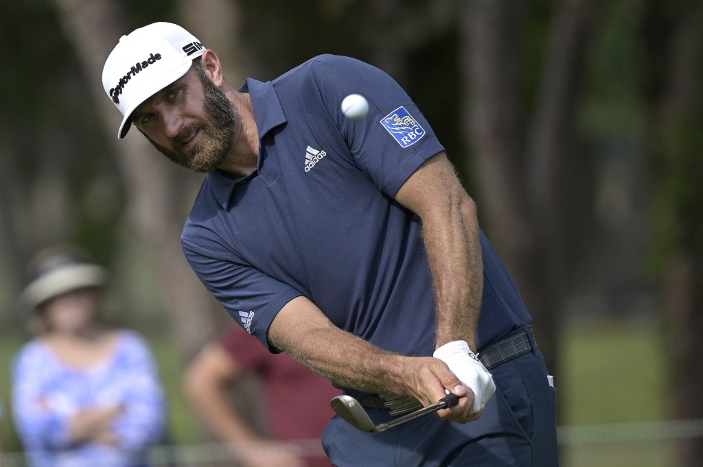 Dustin Johnson chips onto the sixth green during the final round of the Valspar Championship golf tournament, Sunday, May 2, 2021, in Palm Harbor, Fla...