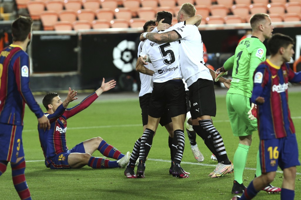 Valencia's Gabriel Paulista celebrates with team mates scoring the opening goal during the Spanish La Liga soccer match between Valencia and Barcelona...