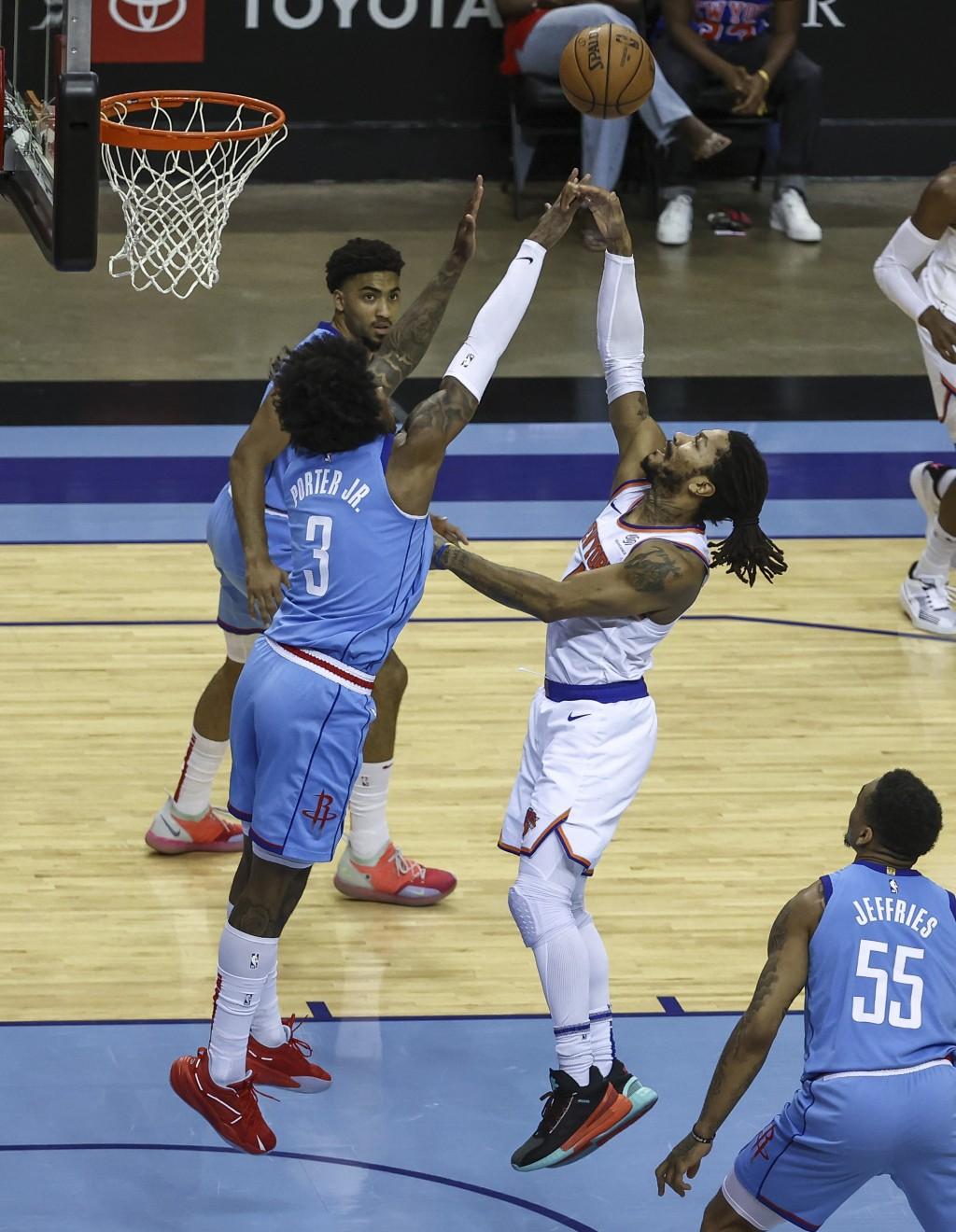 New York Knicks guard Derrick Rose (4) shoots the ball as Houston Rockets guard Kevin Porter Jr. (3) defends during the first quarter of an NBA basket...