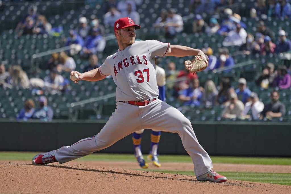 Los Angeles Angels starting pitcher Dylan Bundy throws against the Seattle Mariners during the third inning of a baseball game, Sunday, May 2, 2021, i...
