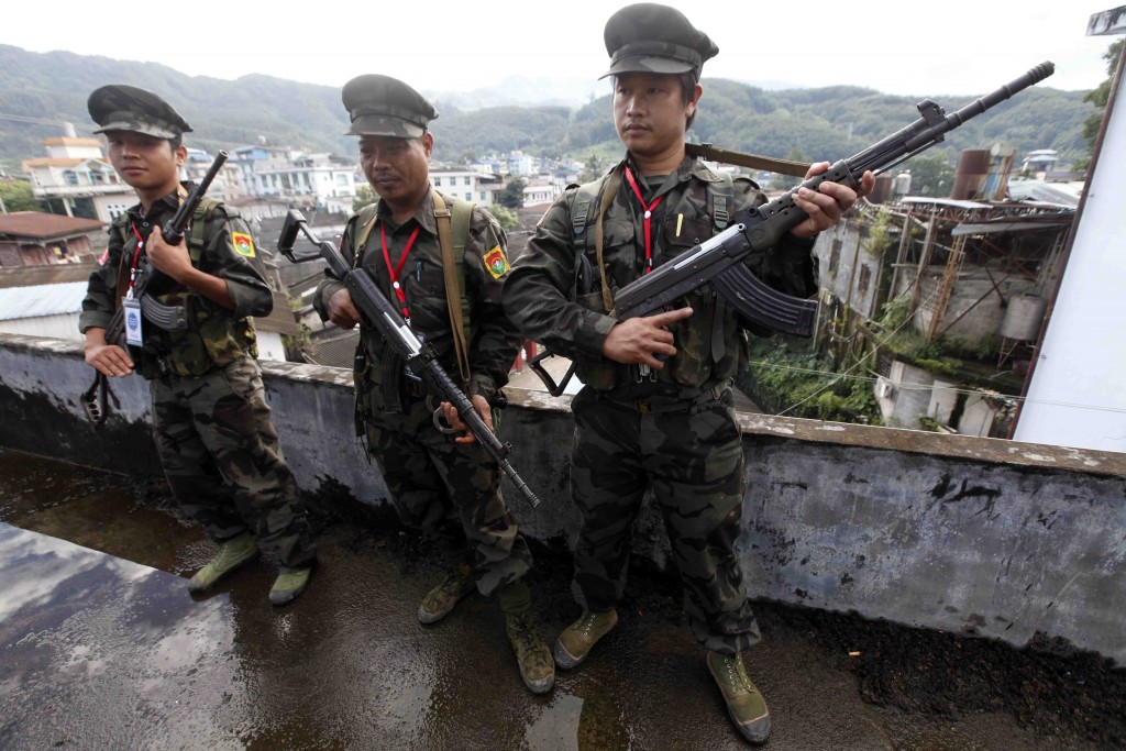 FILE - In this Oct. 29, 2013, file photo, soldiers of the Kachin Independence Army (KIA) stand on guard in Laiza, a border town of China and Myanmar, ...