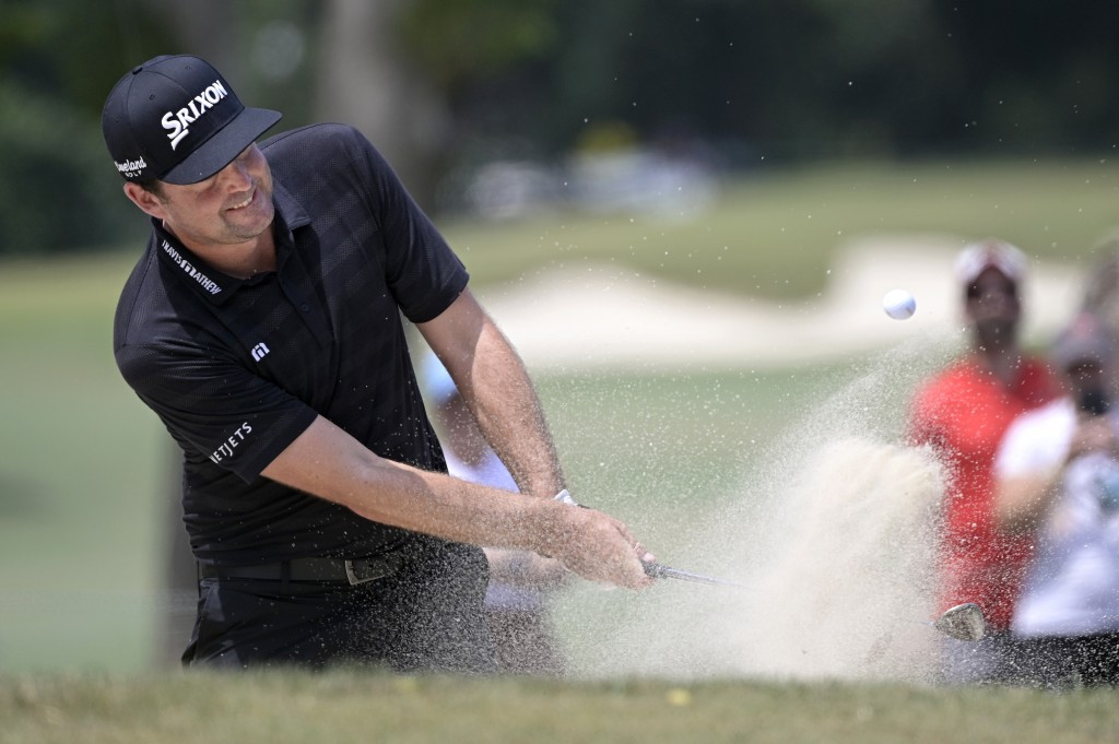Keegan Bradley hits from a bunker onto the third green during the final round of the Valspar Championship golf tournament, Sunday, May 2, 2021, in Pal...