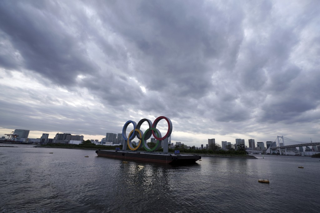 FILE - This April 12, 2021, file photo shows the Olympic rings floating in the water in the Odaiba section in Tokyo. Some nurses in Japan are incensed...