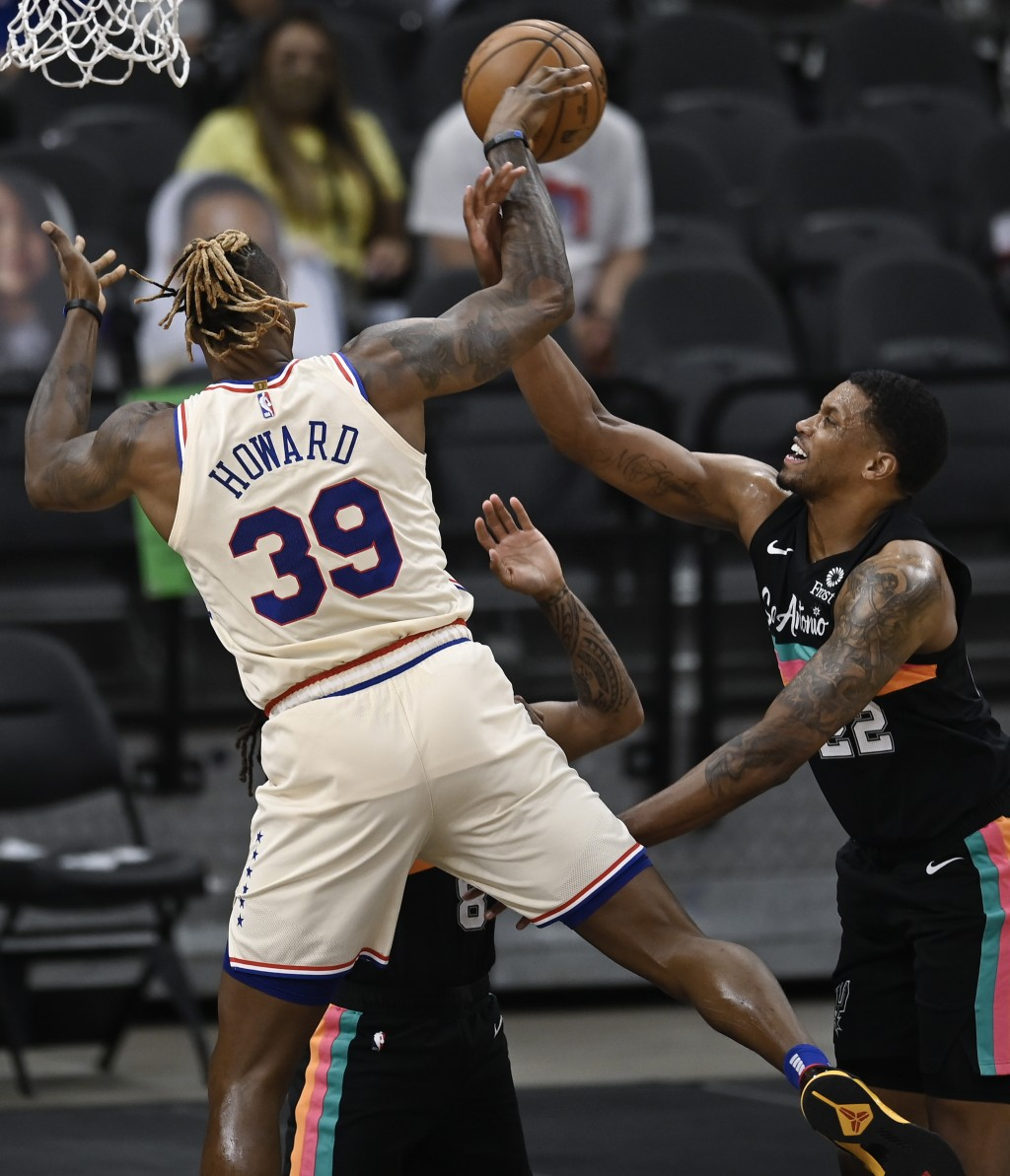 Philadelphia 76ers' Dwight Howard (39) is fouled as he attempts to shoot against San Antonio Spurs Rudy Gay, right, and Patty Mills during the first h...