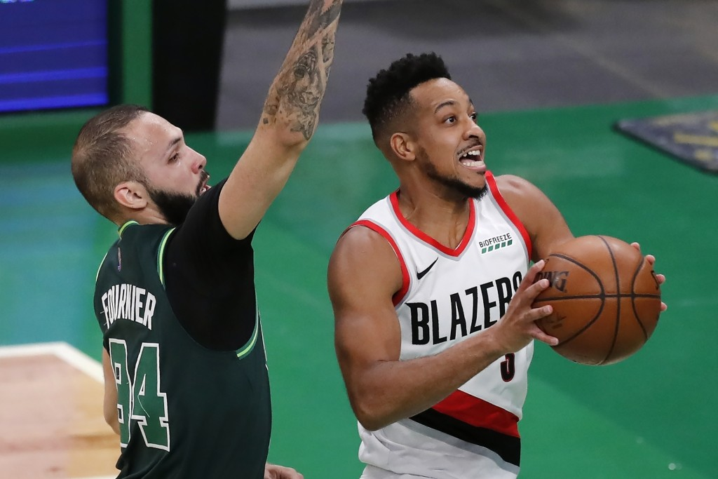 Portland Trail Blazers' CJ McCollum (3) shoots against Boston Celtics' Evan Fournier (94) during the first half of an NBA basketball game, Sunday, May...