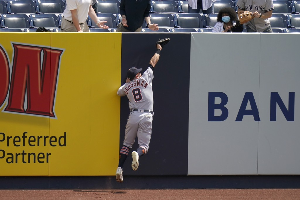 Detroit Tigers right fielder Robbie Grossman grabs a sacrifice fly hit by New York Yankees' Brett Gardner during the second inning of a baseball game ...