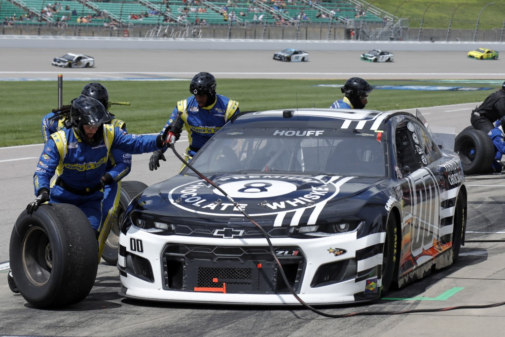 Quin Houff stops on pit road for a tire change during a NASCAR Cup Series auto race at Kansas Speedway in Kansas City, Kan., Sunday, May 2, 2021. (AP ...
