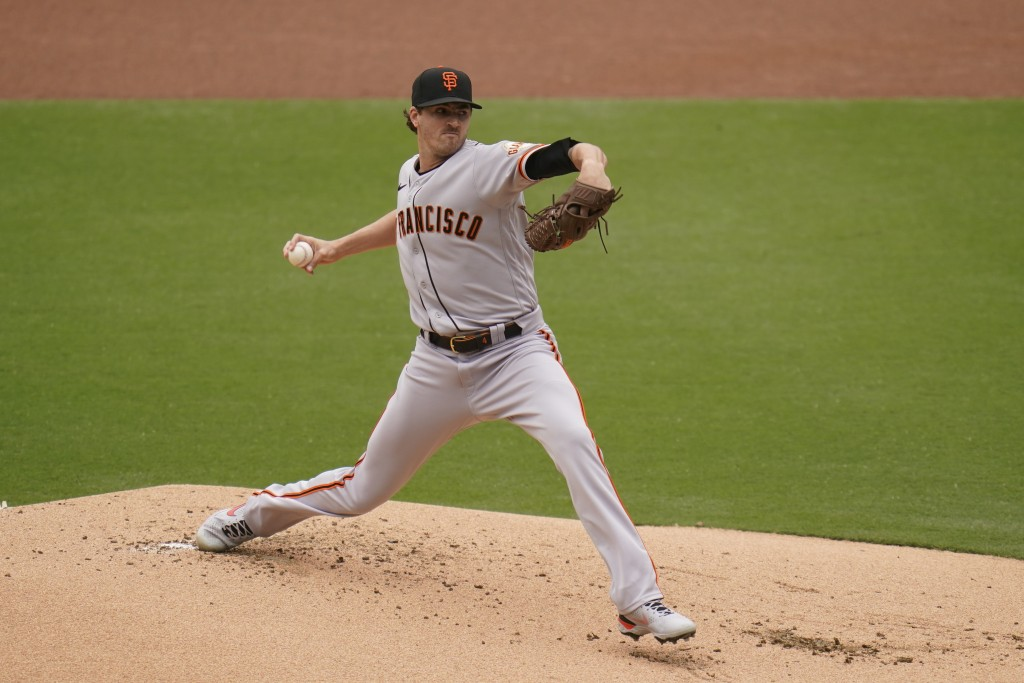 San Francisco Giants starting pitcher Kevin Gausman works against a San Diego Padres batter during the first inning of a baseball game Sunday, May 2, ...