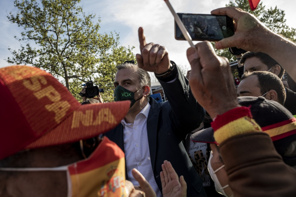 Far-right Vox party deputy Javier Ortega Smith attends an election campaign rally in Madrid, Spain, Wednesday, April 7, 2021. Residents in Madrid, one...