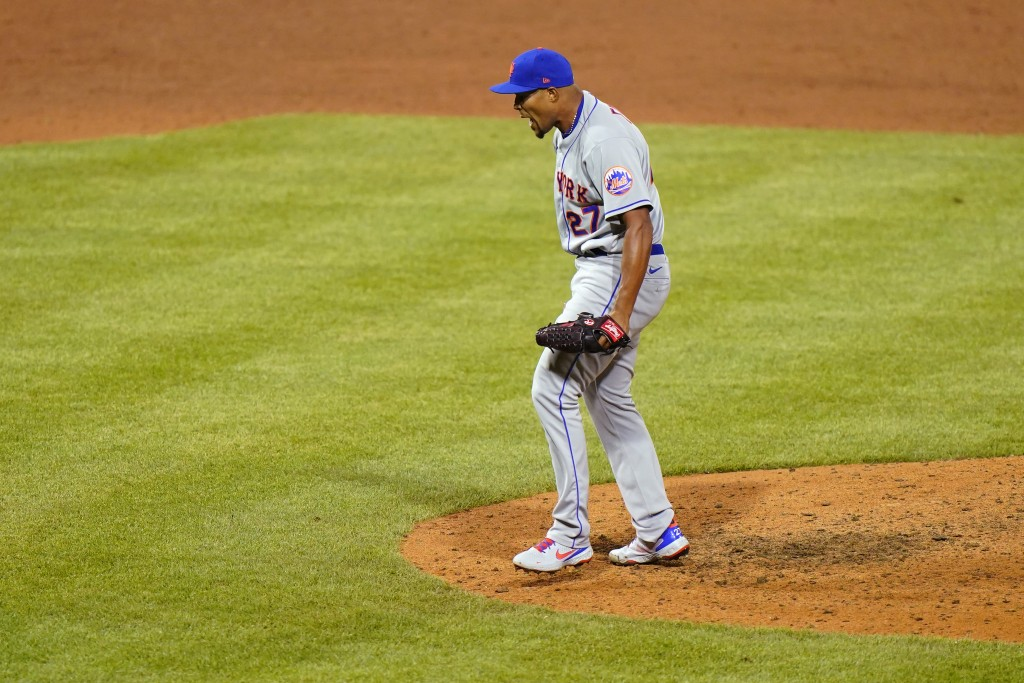 New York Mets pitcher Jeurys Familia reacts after striking out Philadelphia Phillies' Bryce Harper to end a baseball game, Sunday, May 2, 2021, in Phi...