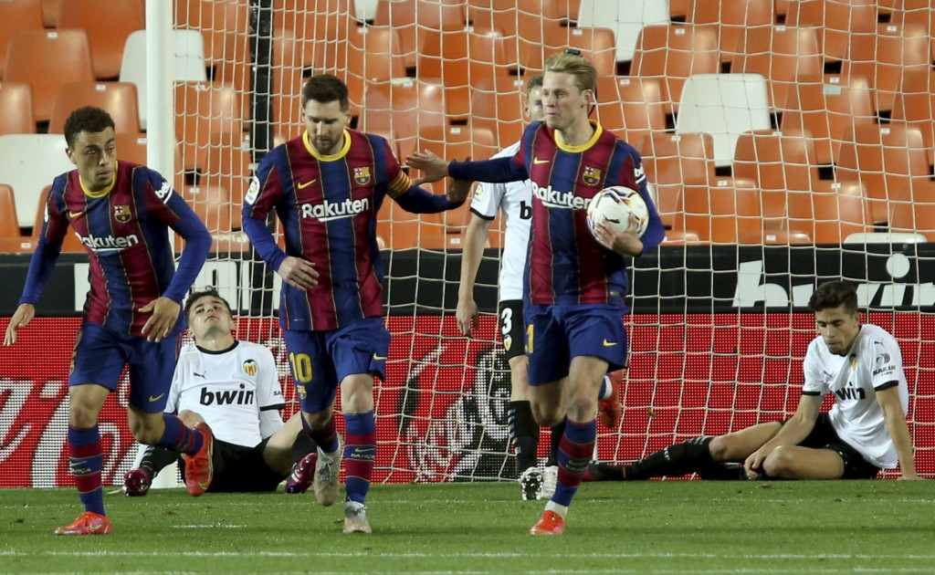 Barcelona's Lionel Messi celebrates scoring his side's first goal during the Spanish La Liga soccer match between Valencia and Barcelona at the Mestal...