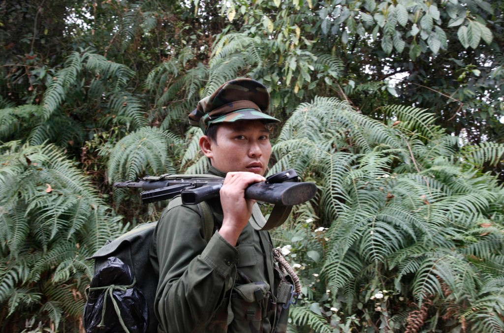 In this March 17, 2018, photo, a Kachin Independence Army fighter walks along a jungle path from the Mu Du front line toward Hpalap outpost in an area...