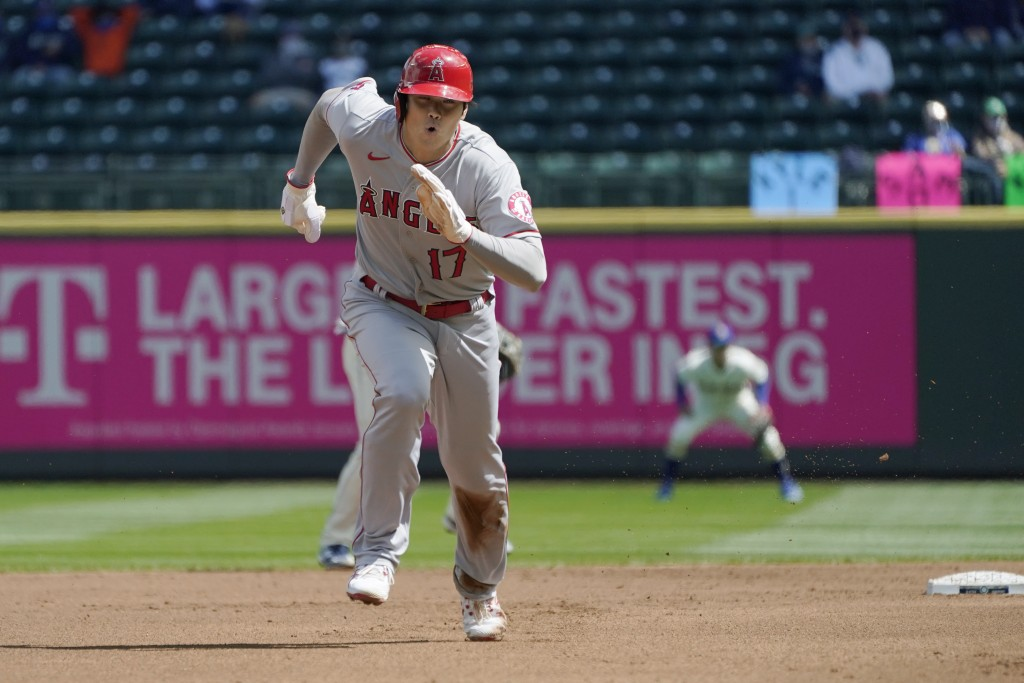 Los Angeles Angels' Shohei Ohtani (17) takes off to safely steal third base during the first inning of a baseball game against the Seattle Mariners, S...