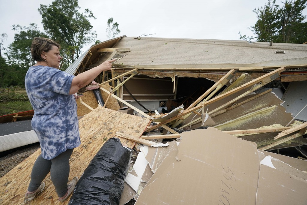 Vickie Savell gestures whole looking at the remains of her new mobile home early Monday, May 3, 2021, in Yazoo County, Miss. Multiple tornadoes were r...