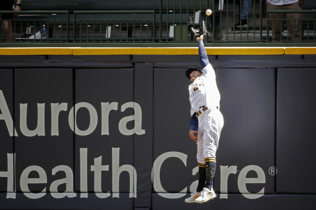 Milwaukee Brewers' Avisail Garcia is unable to catch a ball during the second inning of a baseball game Sunday, May 2, 2021, in Milwaukee. (AP Photo/A...