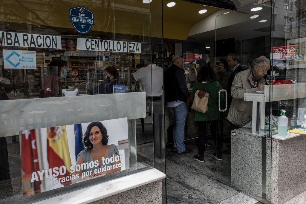 A banner in support of conservative leader Isabel Diaz Ayuso in a bar in Madrid, Spain, Monday, April 19, 2021. Residents in Madrid, one of Europe's w...