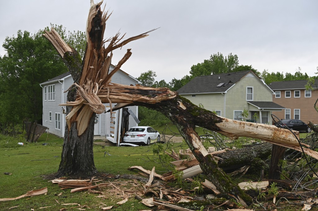 A downed tree and damaged homes are seen along Elvis Presley Drive in Tupelo, Miss., Monday, May 3, 2021. Multiple tornadoes were reported across Miss...
