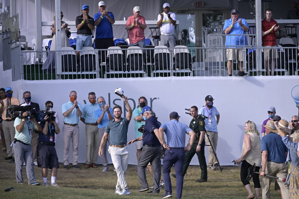 Sam Burns waves his hat to the crowd on the 18th green after winning the Valspar Championship golf tournament, Sunday, May 2, 2021, in Palm Harbor, Fl...