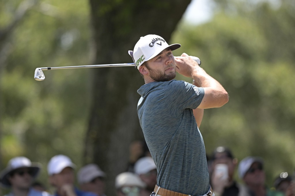Sam Burns watches his tee shot on the second hole during the final round of the Valspar Championship golf tournament, Sunday, May 2, 2021, in Palm Har...