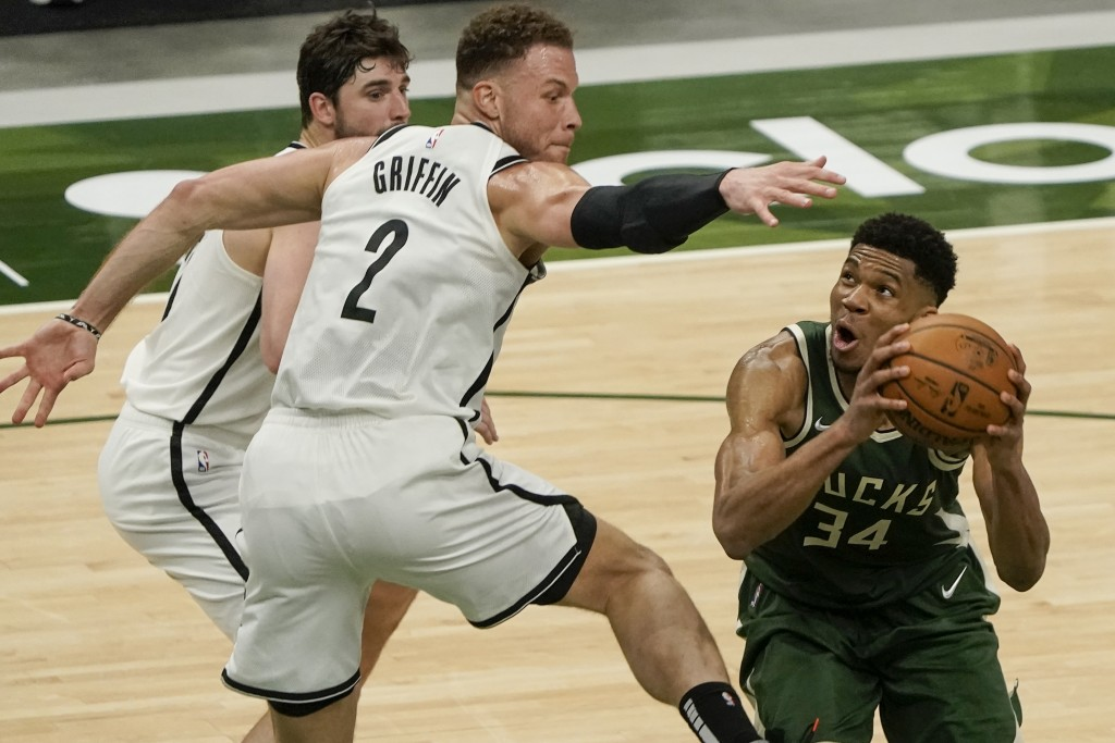 Milwaukee Bucks' Giannis Antetokounmpo shoots past Brooklyn Nets' Blake Griffin during the second half of an NBA basketball game Sunday, May 2, 2021, ...