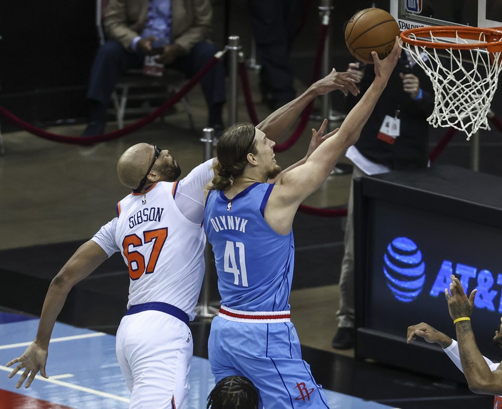 Houston Rockets forward Kelly Olynyk (41) shoots the ball as New York Knicks center Taj Gibson (67) defends during the second quarter of an NBA basket...