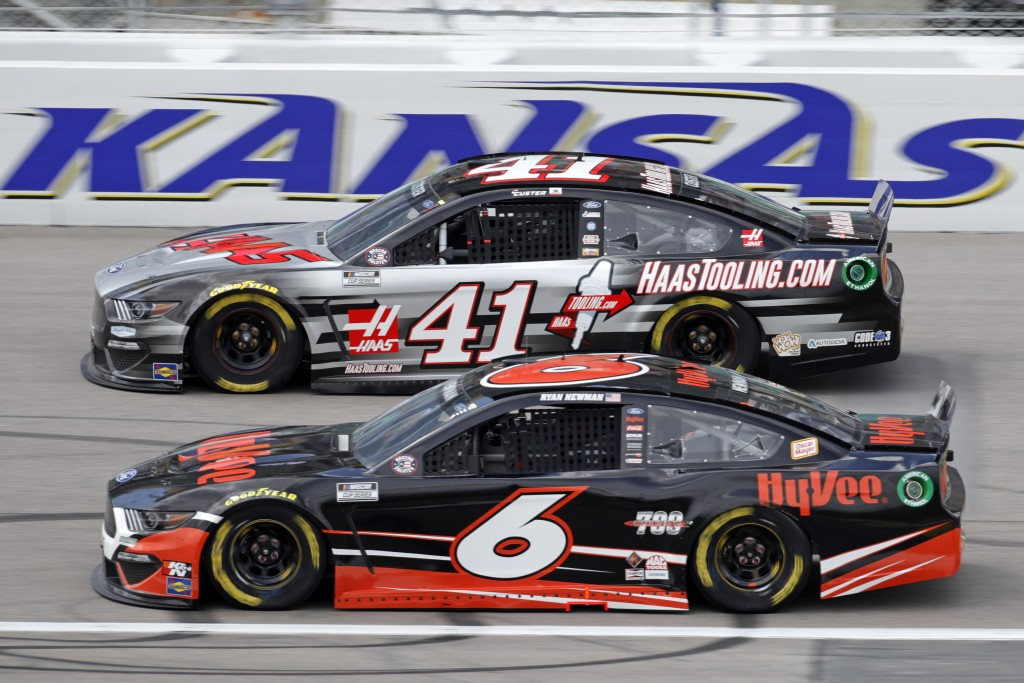 Cole Custer (41) and Ryan Newman (6) head toward turn one during a NASCAR Cup Series auto race at Kansas Speedway in Kansas City, Kan., Sunday, May 2,...