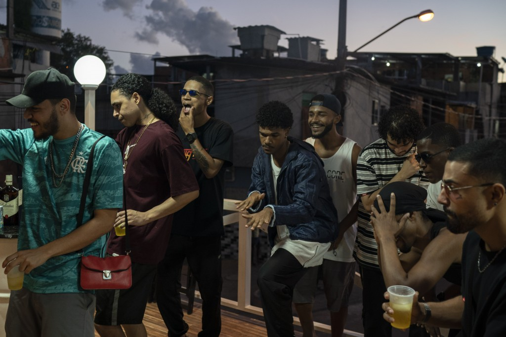 """Trap de Cria artists Ramon Silva, known as """"Suav,"""" from left, Brendon Oliveira """"Trezenit,"""" and Erison de Araujo """"DeAra"""" perform with other artists and..."""