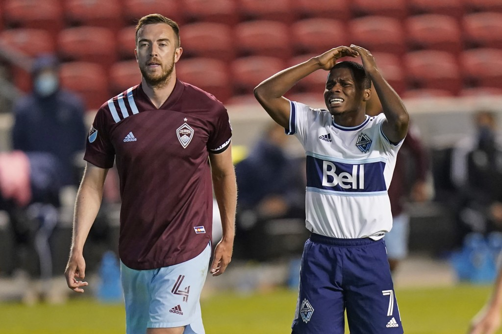 Vancouver Whitecaps forward Deiber Caicedo (7) reacts after missing his shot on goal as Colorado Rapids' Danny Wilson (4) looks on in the second half ...