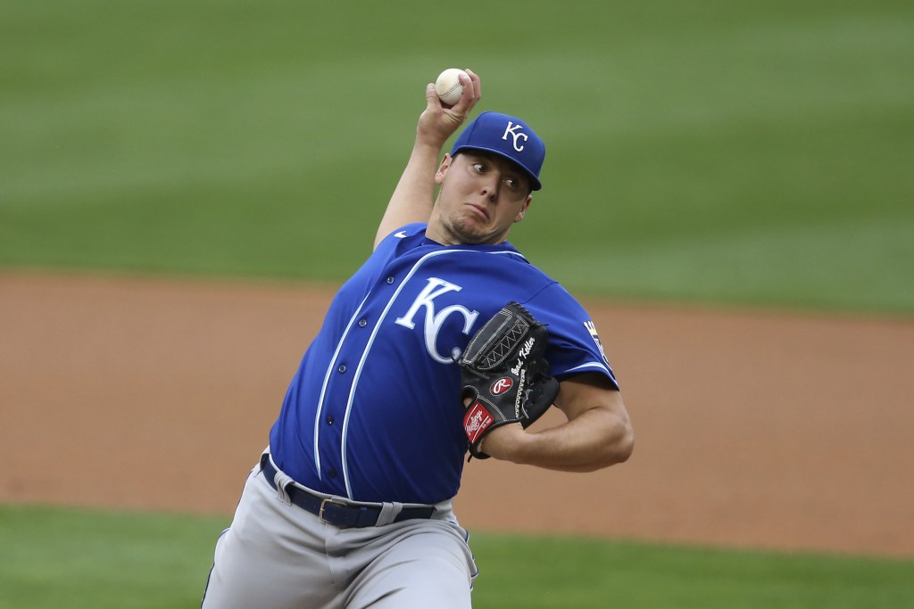 Kansas City Royals' pitcher Brad Keller throws against the Minnesota Twins during the first inning of a baseball game, Sunday, May 2, 2021, in Minneap...