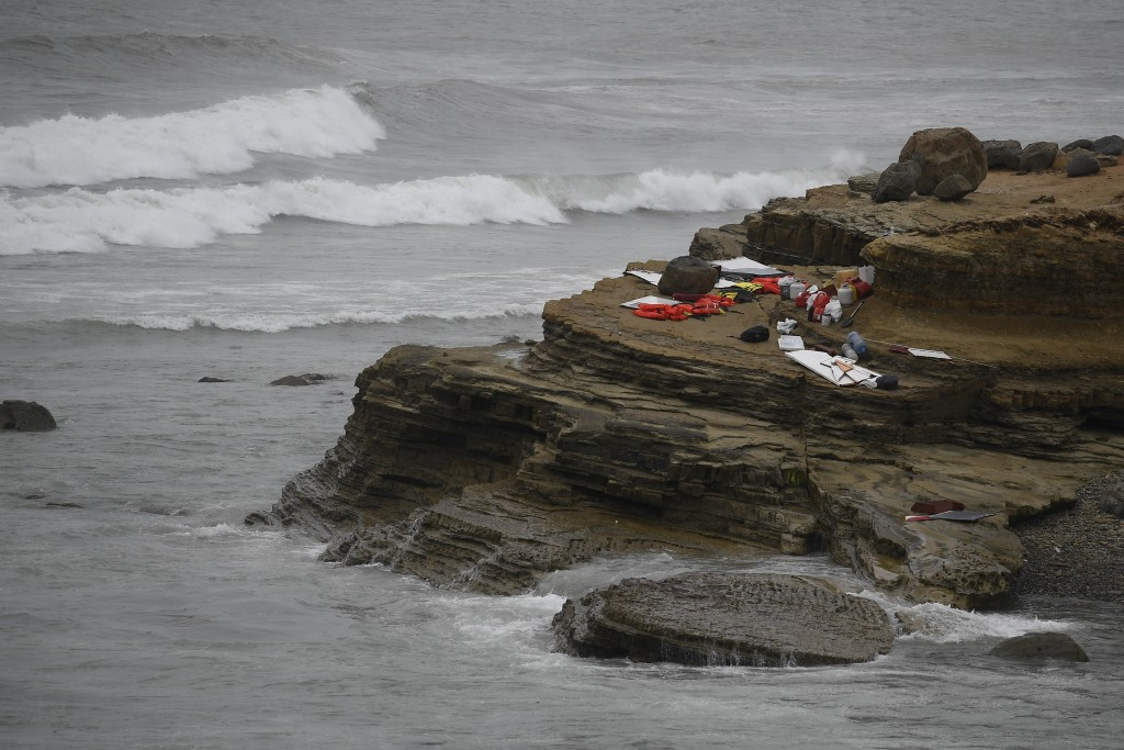 Items from a boat sit on the shoreline at Cabrillo National Monument near where it capsized just off the San Diego coast Sunday, May 2, 2021, in San D...