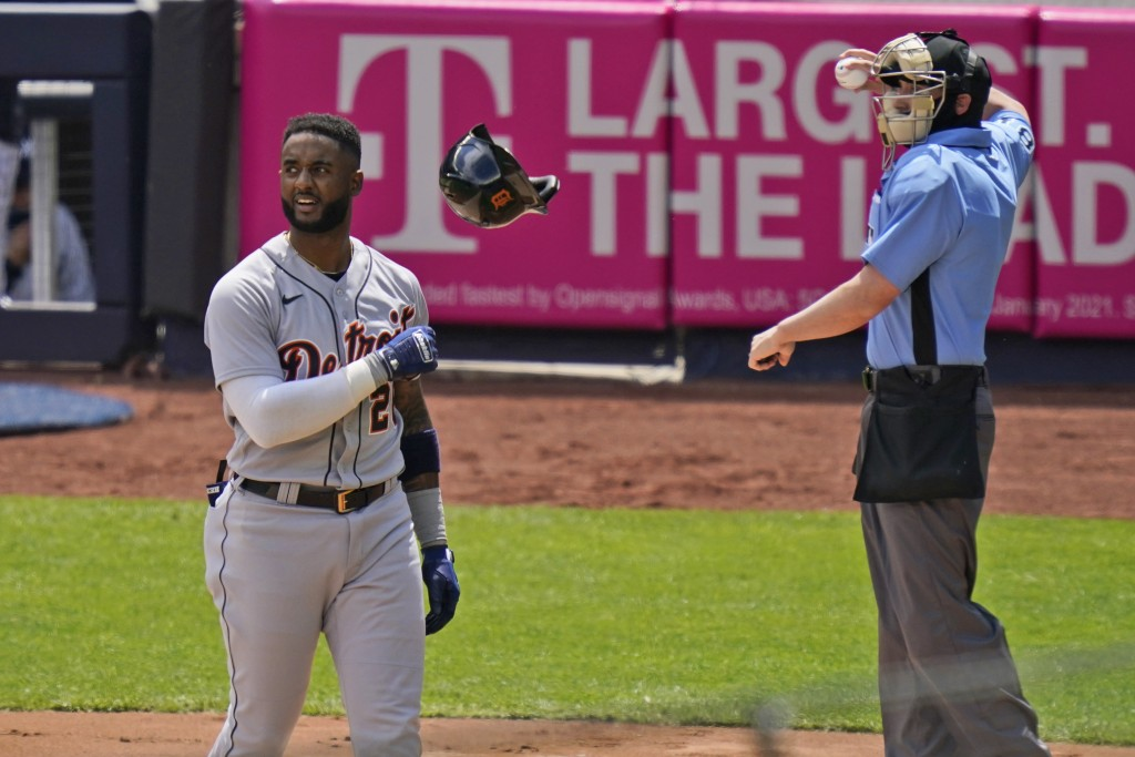 Detroit Tigers' Niko Goodrum, left, throws his helmet after striking out during the second inning of a baseball game against the New York Yankees at Y...