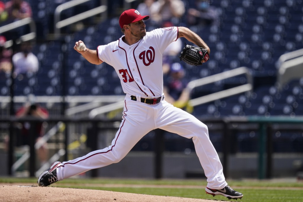 Washington Nationals starting pitcher Max Scherzer throws during the first inning of a baseball game against the Miami Marlins at Nationals Park, Sund...
