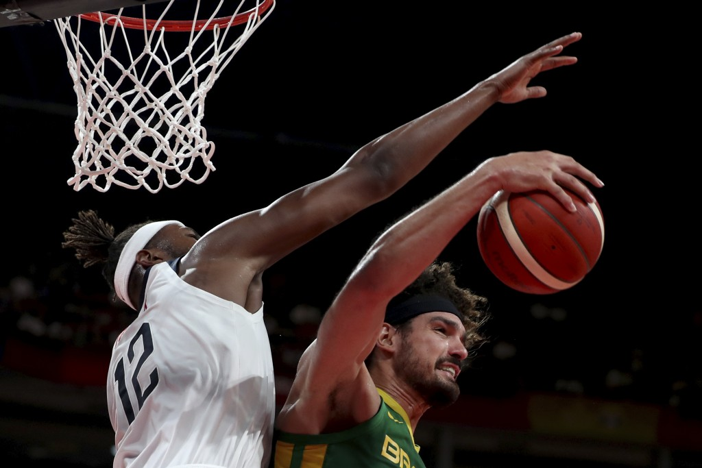FILE - In this Sept. 9, 2019, file photo, Brazil's Anderson Varejao, right, keeps the ball from United States' Myles Turner during a match for the FIB...