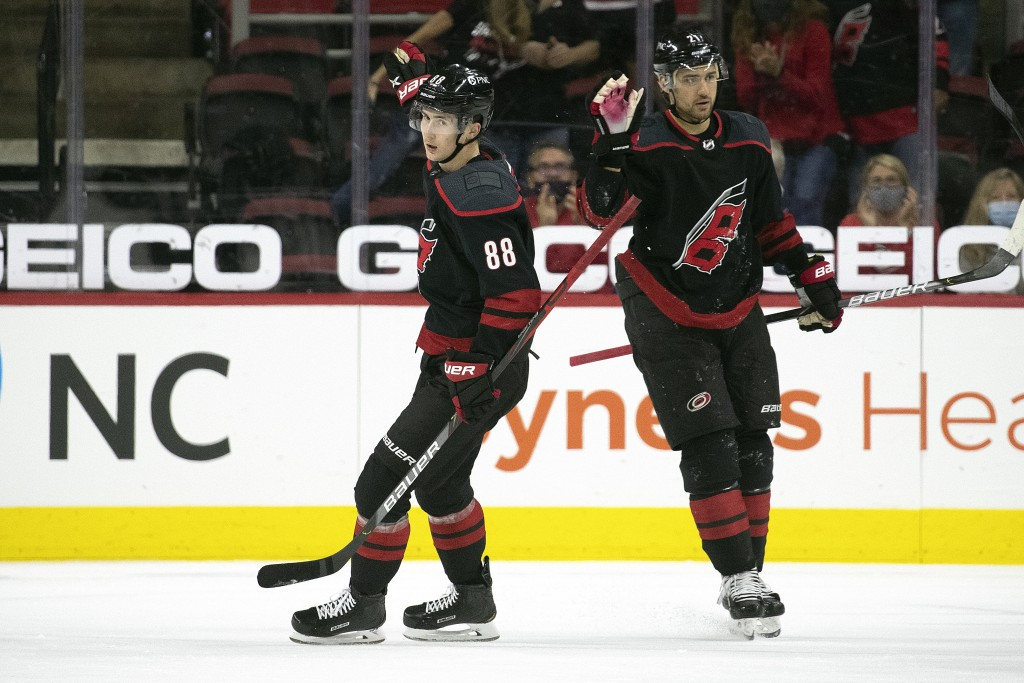 Carolina Hurricanes' Martin Necas (88) celebrates his goal with teammate Nino Niederreiter (21) during the first period of an NHL hockey game against ...