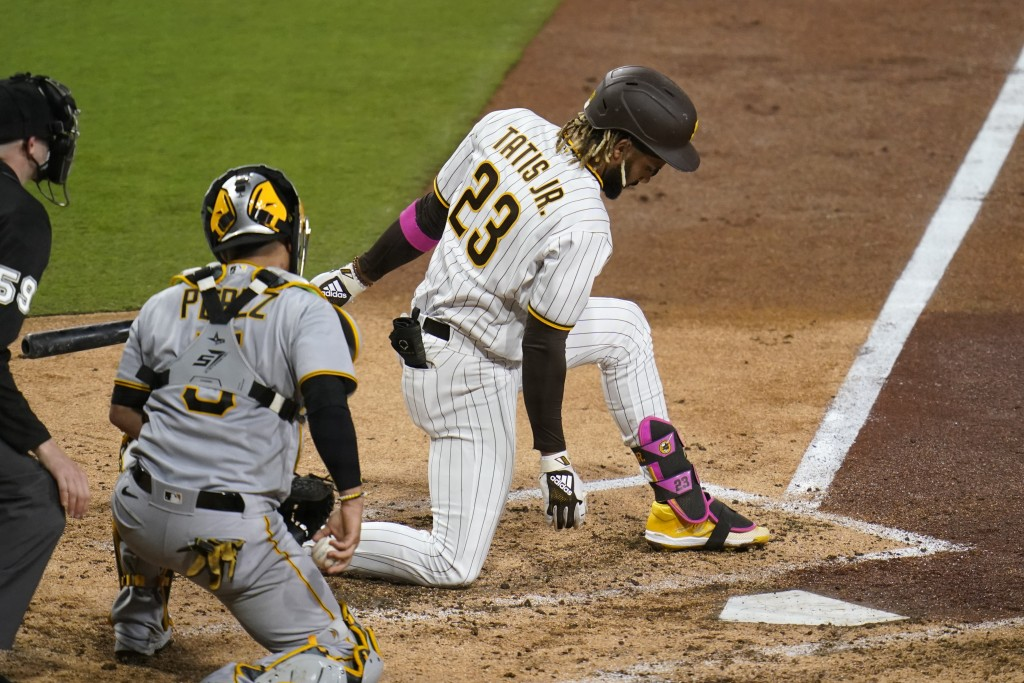 San Diego Padres' Fernando Tatis Jr. strikes out while batting as Pittsburgh Pirates catcher Michael Perez looks on, left, during the sixth inning of ...