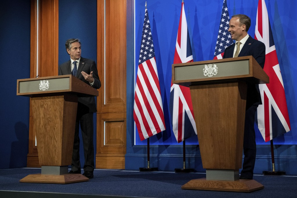 Britain's Foreign Secretary Dominic Raab, right, and US Secretary of State Antony Blinken attend a joint press conference at Downing Street in London,...