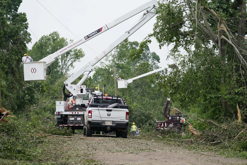 Utility linemen work on repairing power and communication lines in Yazoo County, Miss., Monday, May 3, 2021, following Sunday's tornado that destroyed...