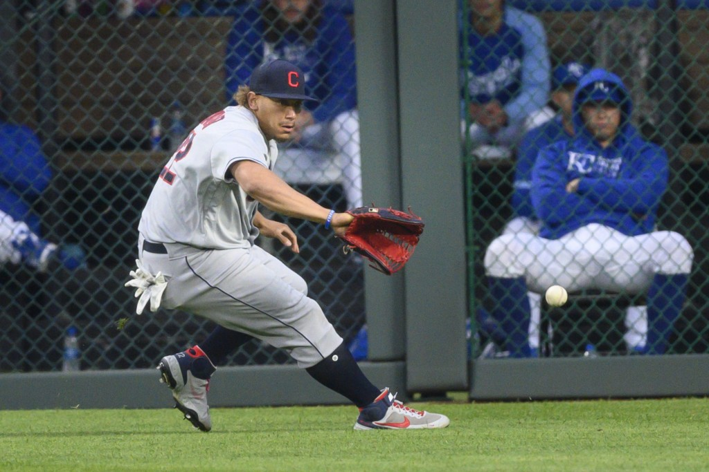 Cleveland Indians left fielder Josh Naylor fields a single by Kansas City Royals' Whit Merrifield during the first inning of a baseball game Monday, M...