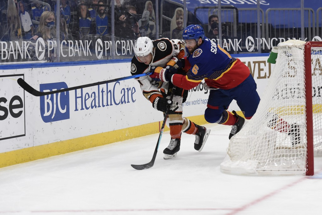 St. Louis Blues' Marco Scandella (6) checks Anaheim Ducks' Troy Terry (61) during the third period of an NHL hockey game on Monday, May 3, 2021, in St...
