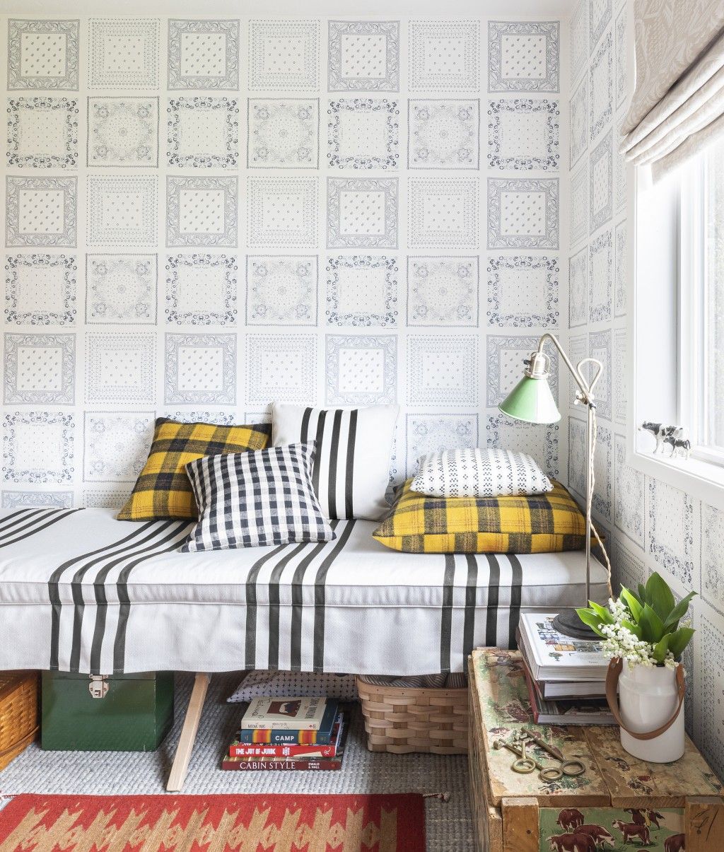 This image released by Portland Oregon-based interior designer Max Humphrey shows a room with a wallpaper design inspired by  bandanas. (Christopher D...