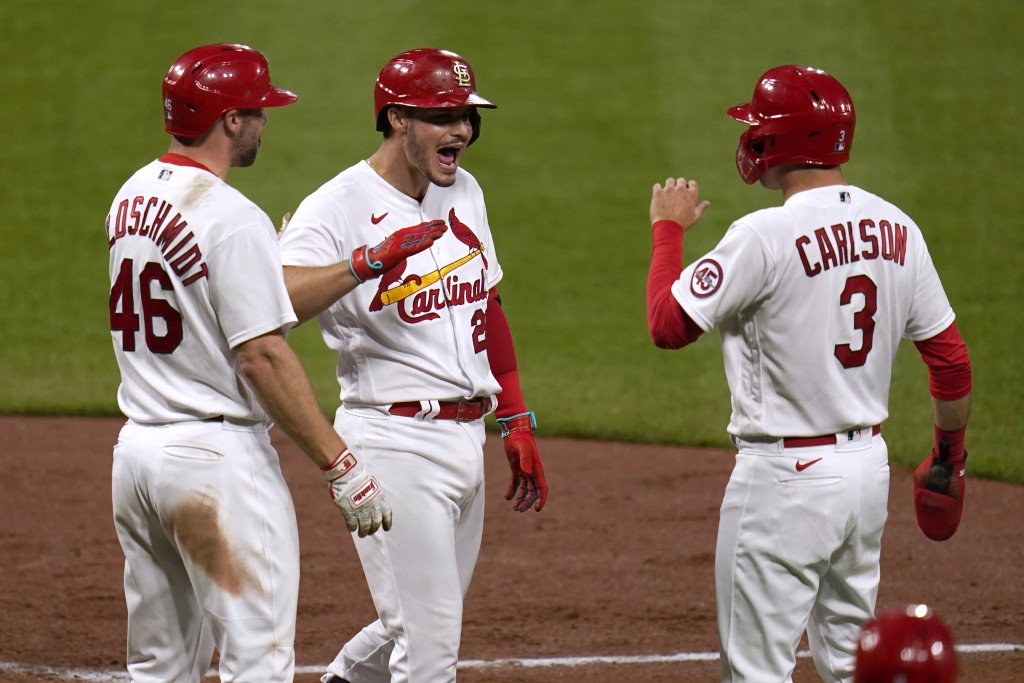 St. Louis Cardinals' Nolan Arenado is congratulated by teammates Paul Goldschmidt (46) and Dylan Carlson (3) after hitting a three-run home run during...