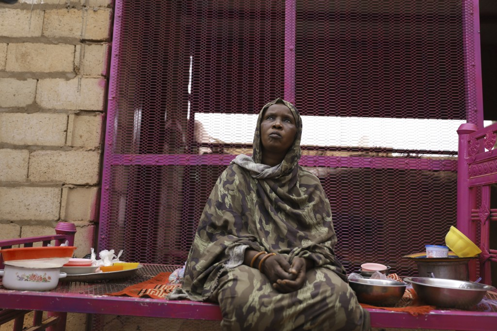 Saadia Ahmed, mother of the Sudanese migrant Mutawakel Ali, sits at her home, in Khartoum, Sudan, Friday April 30, 2021. Ali narrowly missed drowning ...