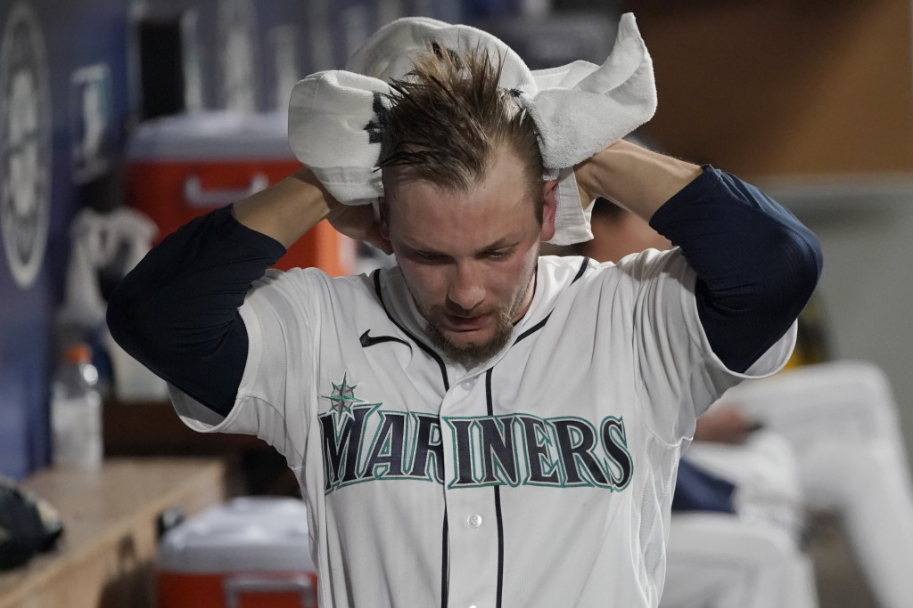 Seattle Mariners pitcher Anthony Misiewicz reacts in the dugout after he was pulled during the eighth inning of a baseball game against the Baltimore ...