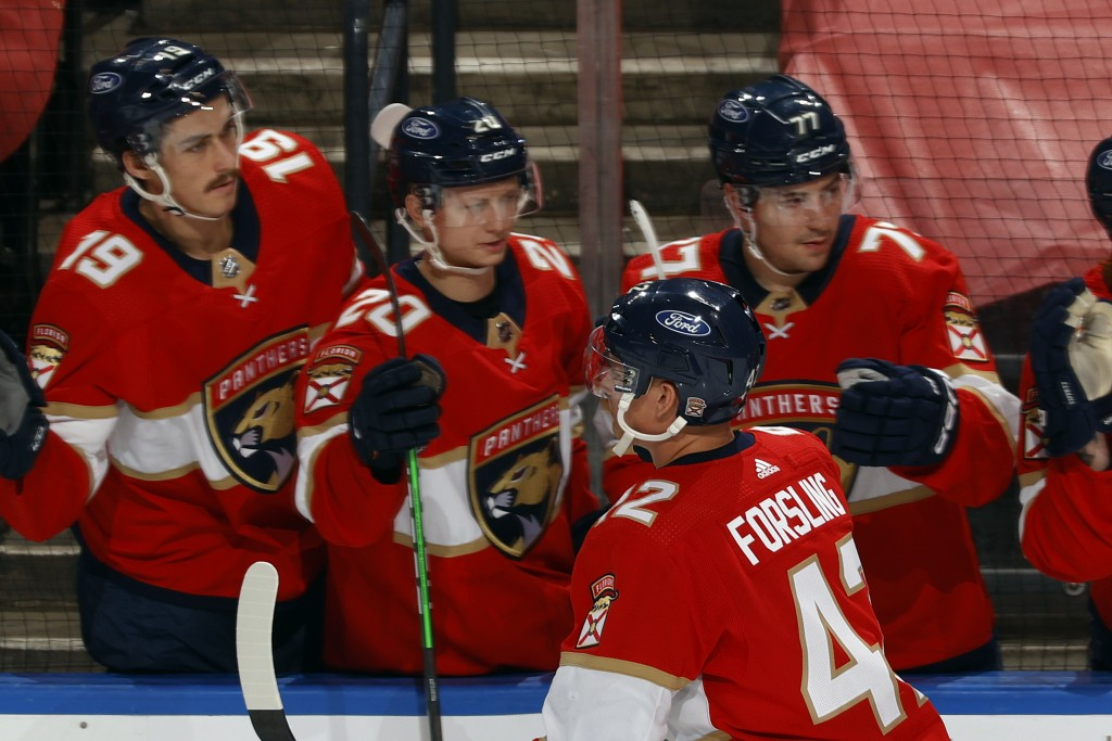 Teammates congratulate Florida Panthers defenseman Gustav Forsling (42) after he scored a goal against the Dallas Stars during the second period of an...
