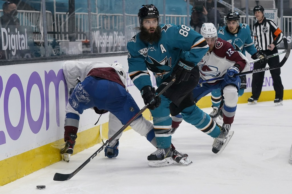 San Jose Sharks defenseman Brent Burns (88) reaches for the puck against the Colorado Avalanche during the second period of an NHL hockey game in San ...