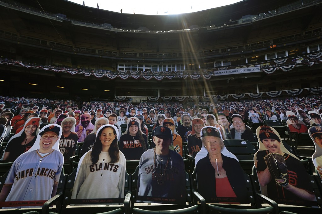 FILE - In this July 28, 2020, file photo, cardboard cutouts of fans sit in seats at Oracle Park before a baseball game between the San Francisco Giant...
