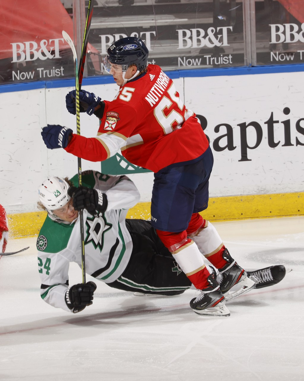 Florida Panthers defenseman Markus Nutivaara (65) takes Dallas Stars left wing Roope Hintz (24) to the ice during the second period of an NHL hockey g...