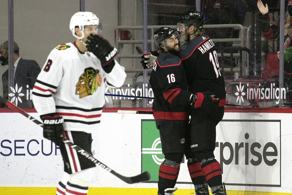 Carolina Hurricanes' Dougie Hamilton (19) celebrates his goal with teammate Vincent Trocheck (16) against the Chicago Blackhawks during the first peri...