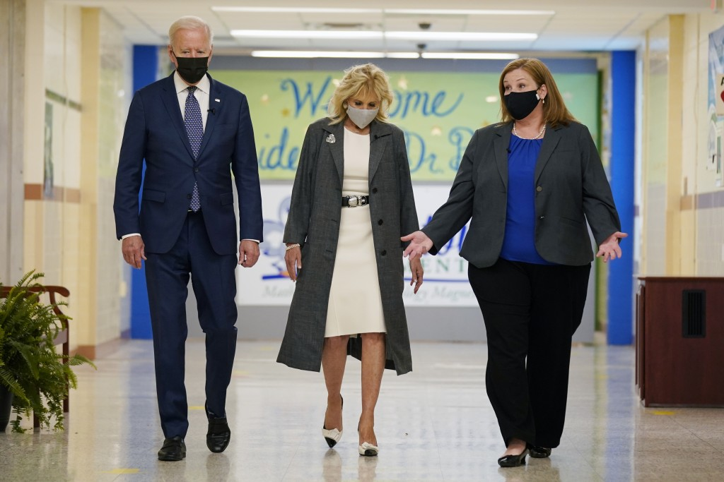 President Joe Biden and first lady Jill Biden, walk with Principal Kelly Denny, during a visit to Yorktown Elementary School, Monday, May 3, 2021, in ...